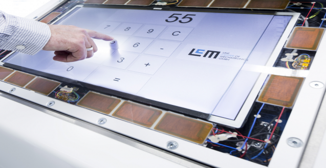 LCM haptic feedback touchscreen